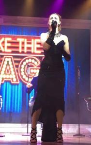 Elle Douglas of three minute heroes performing on stage